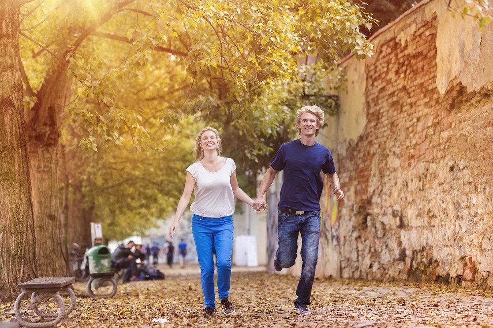 Beautiful young couple taking a walk in autumn city