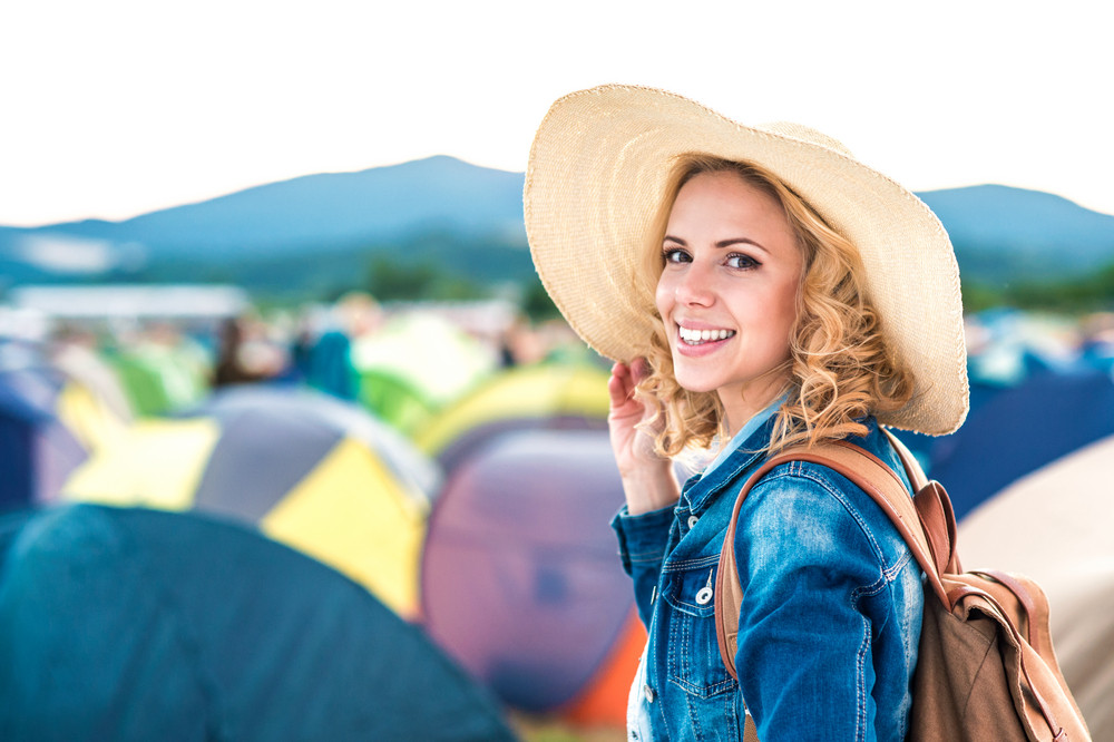 Beautiful young girl at summer tent festival