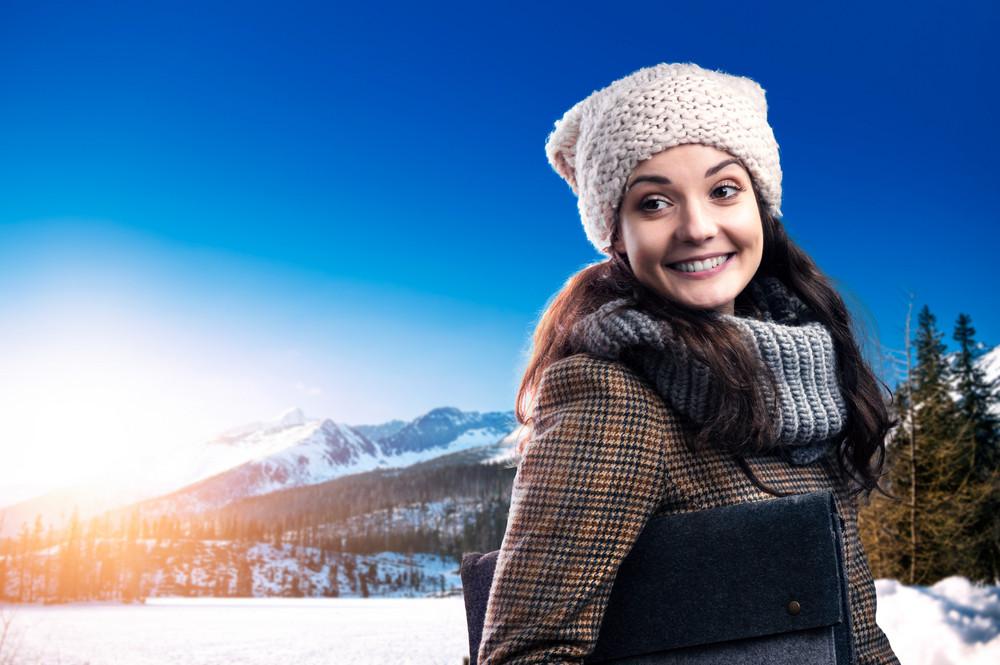 Beautiful young woman enjoying a walk in mountains