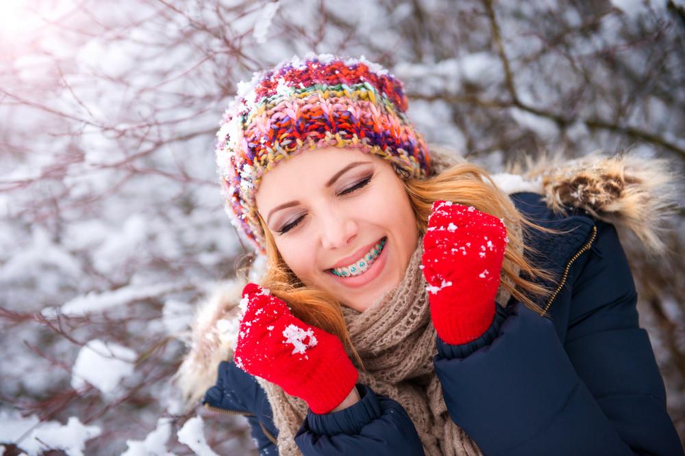 Beautiful young woman having fun outside in winter