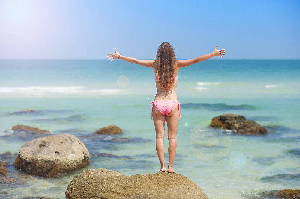 Beautiful young woman is enjoying free time at paradise beach in Phu quoc island, south of vietnam.
