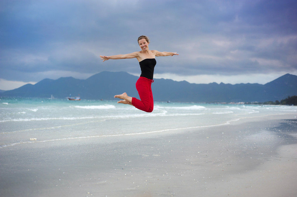 Beautiful young woman is enjoying free time at the beautiful sandy beach