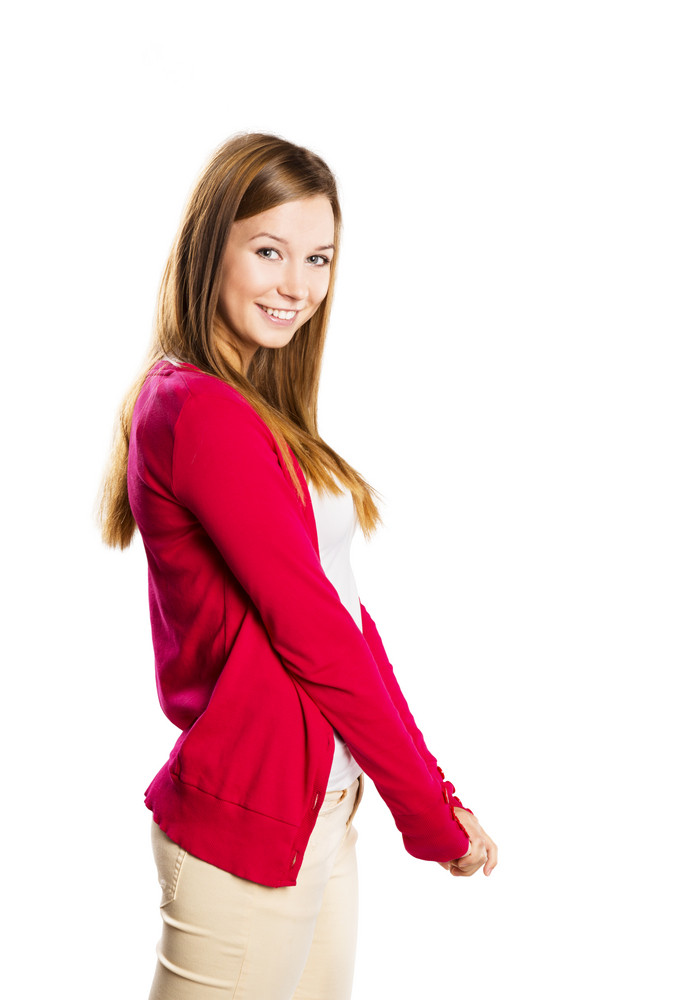 Beautiful young woman posing in studio over a white background
