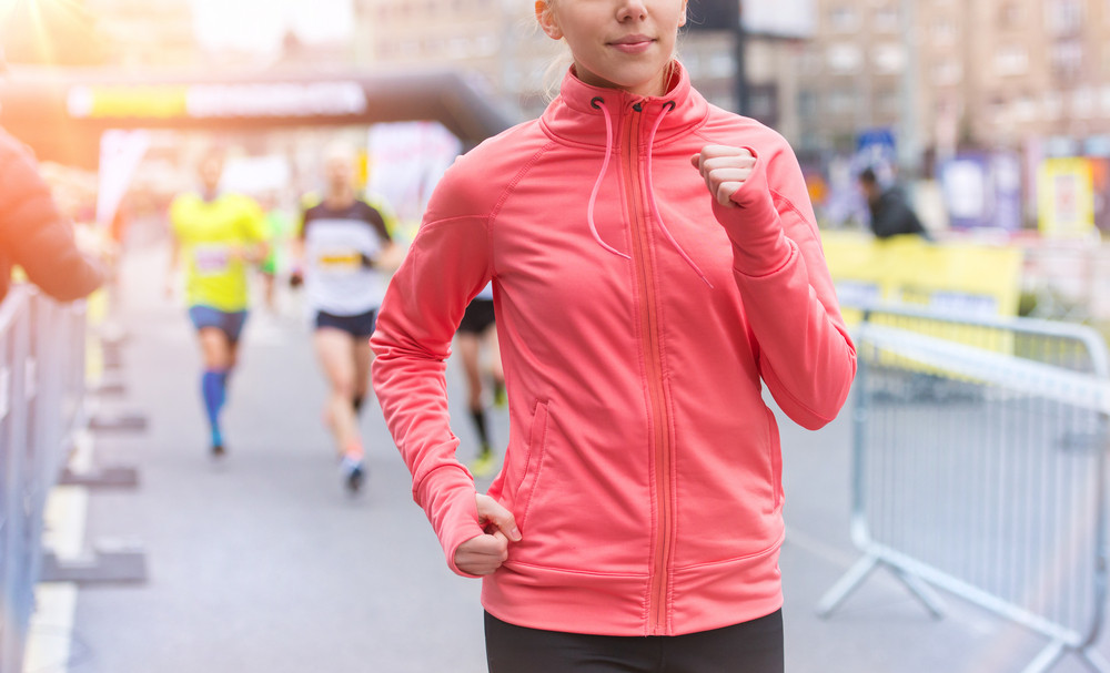 Beautiful young woman running in the city competition