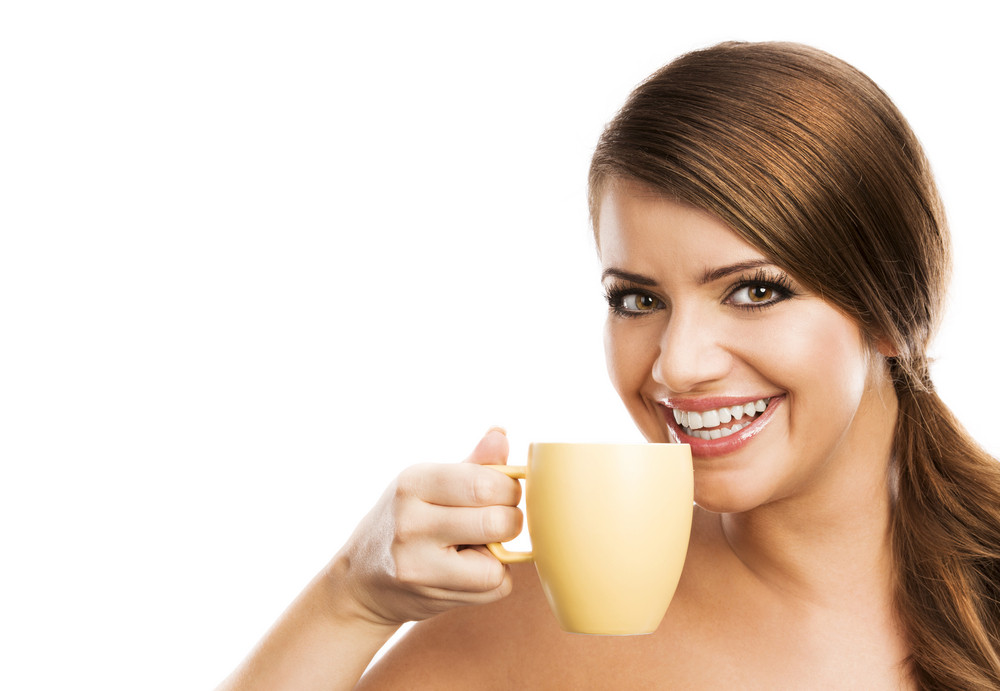 Beautiful young woman with cup of coffee, isolated on white background