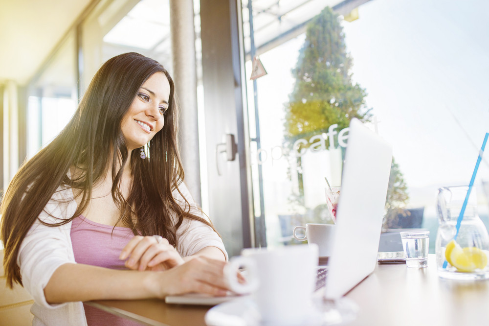 Beautiful young women with tablet in cafe