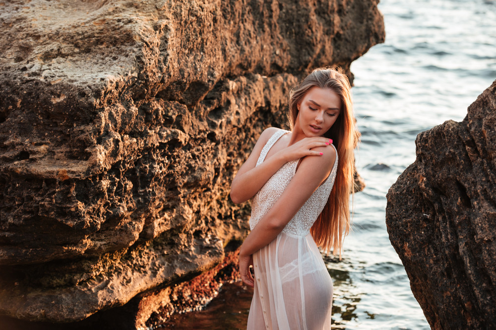 Beauty model in water. on the beach