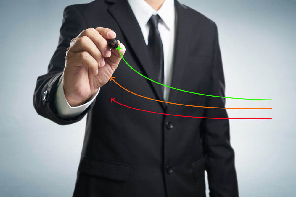 Benchmarking and market leader concept. Manager (businessman, coach, leadership) draw graph with three lines, one of them represent the best company in competition.