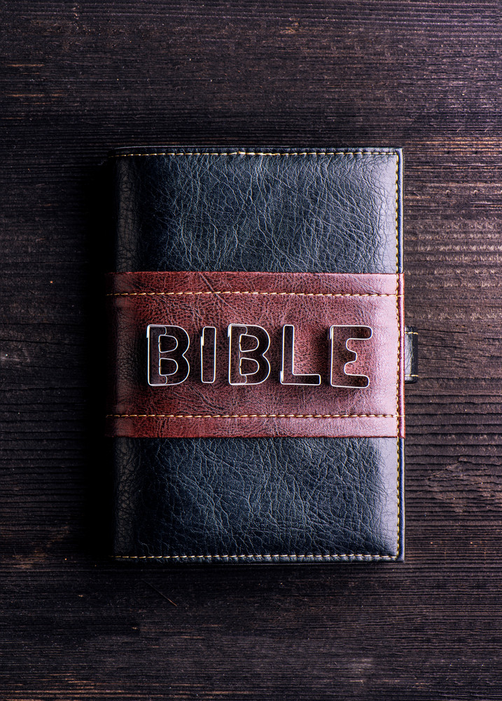Bible In Leather Book Cover Laid On Old Wooden Table Sign Made Of Cookie Cutters
