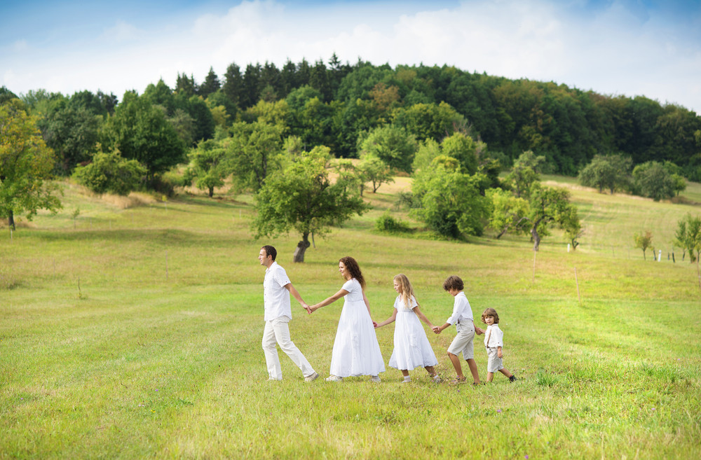 Big family is relaxing together in green nature