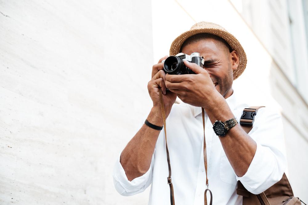 Black man photographs on the street