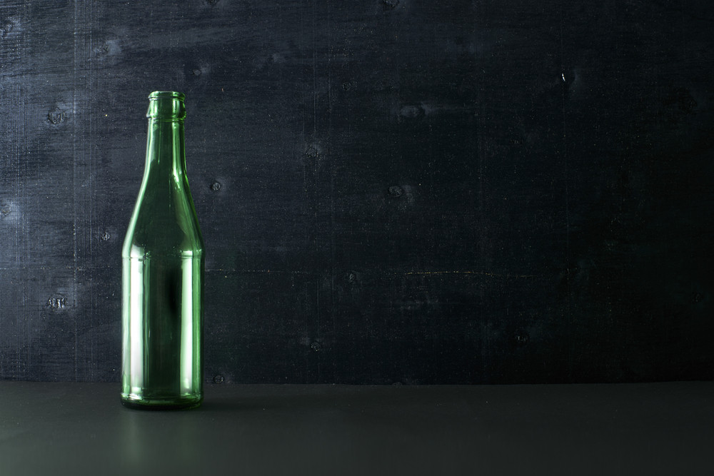 blank green botles on black color background