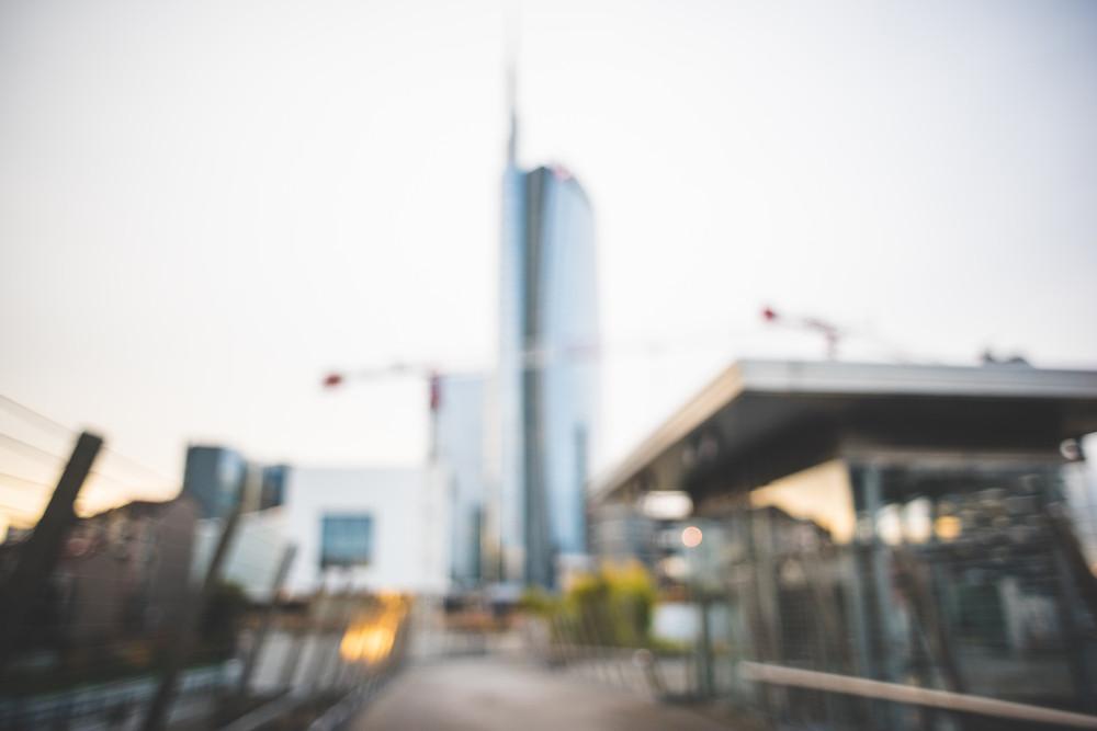 blurred urban milan landscape colored background