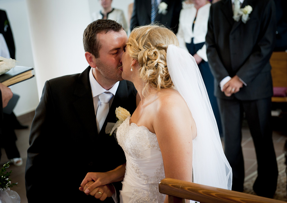 Bride and groom in the church at the wedding day