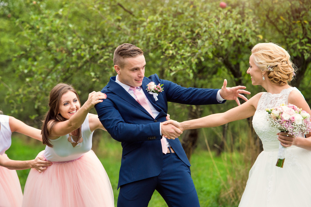 Bride, groom and bridesmaids outside in nature