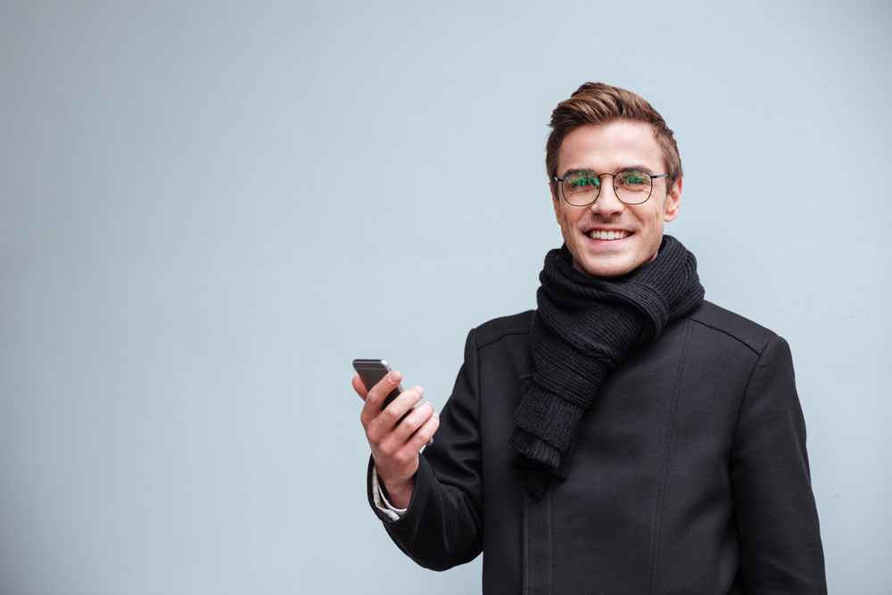 Business man in glasses looking at camera. isolated