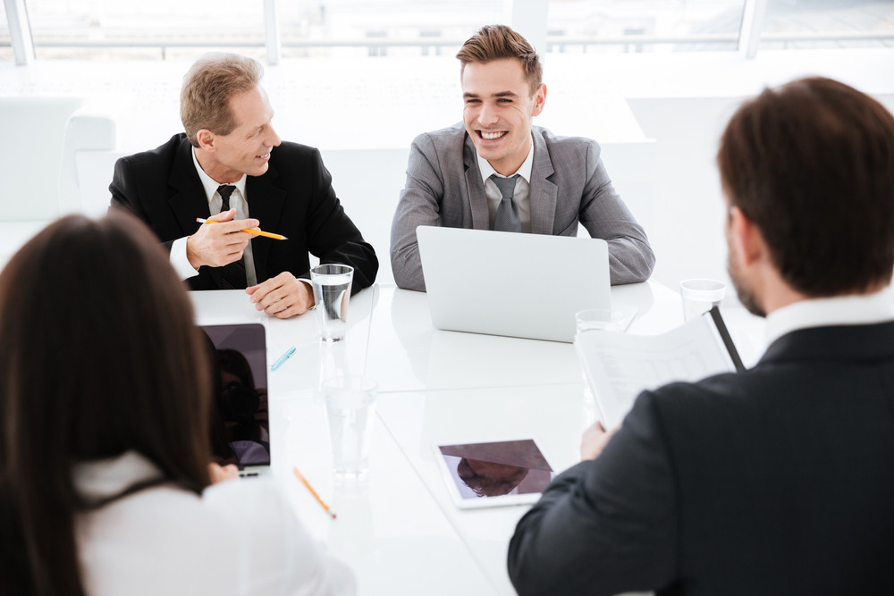 Business People in conference room sitting by the table and during meeting in office