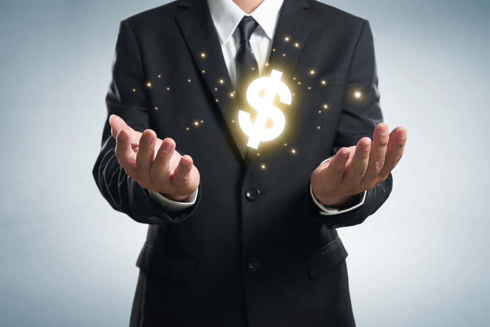 Businessman holding dollar symbol.