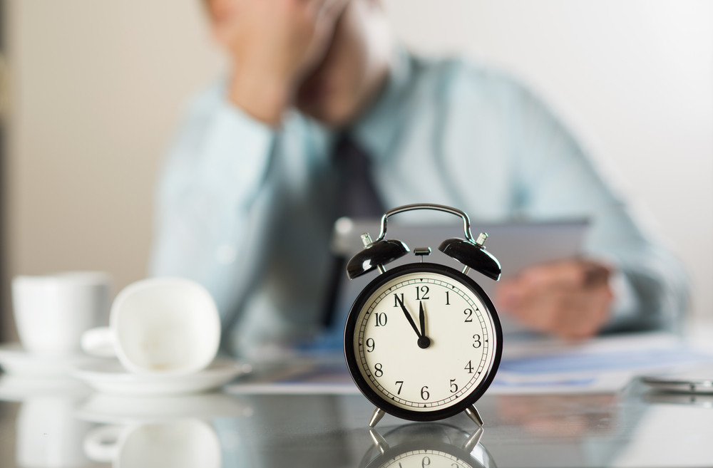 Businessman in office has problem with deadline