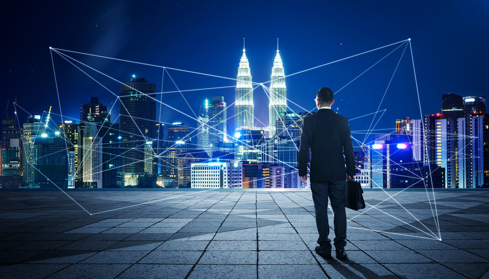 Businessman with city and wireless communication network background, abstract image visual, internet of things