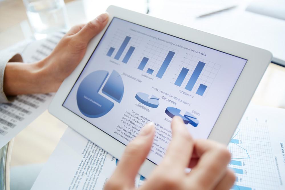 Businesswoman analyzing electronic diagrams