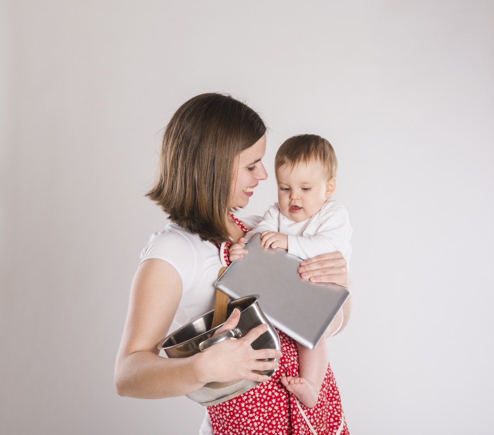 Busy mother and baby with digital tablet.