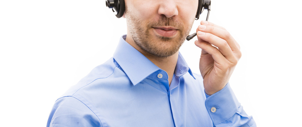 Call center operator isolated on white. Young handsome man with headset.