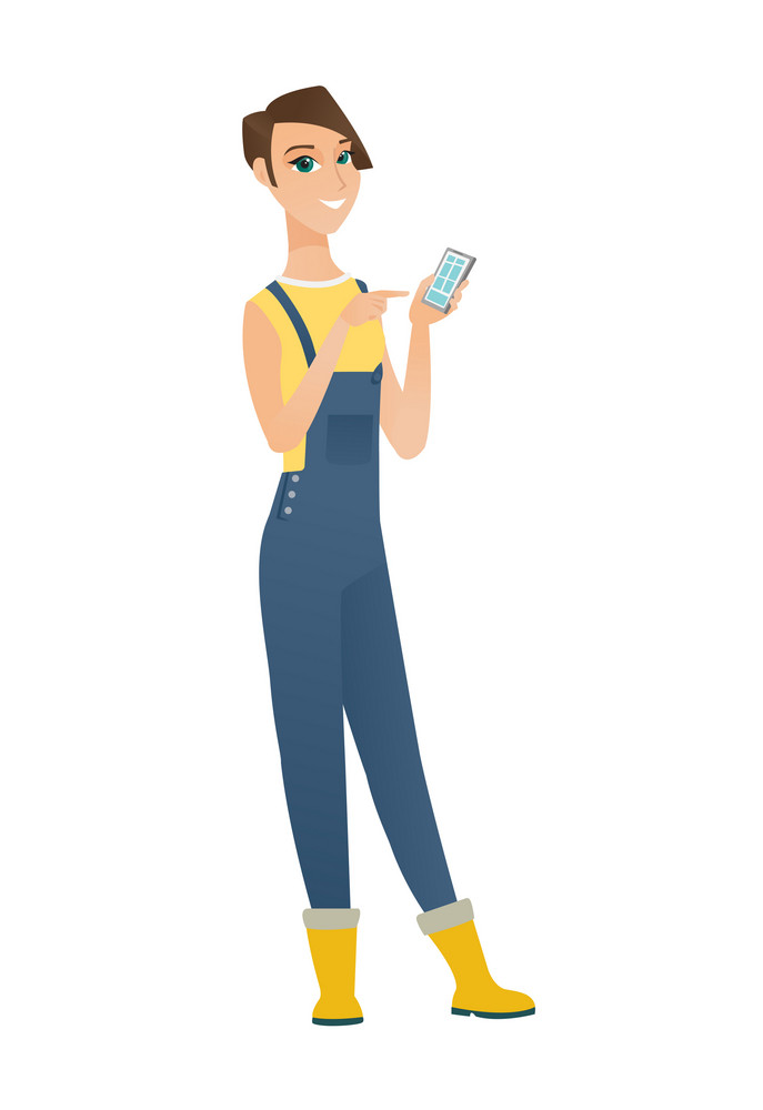 Caucasian farmer in coveralls holding mobile phone and pointing at it. Full length of farmer with mobile phone. Farmer using mobile phone. Vector flat design illustration isolated on white background.