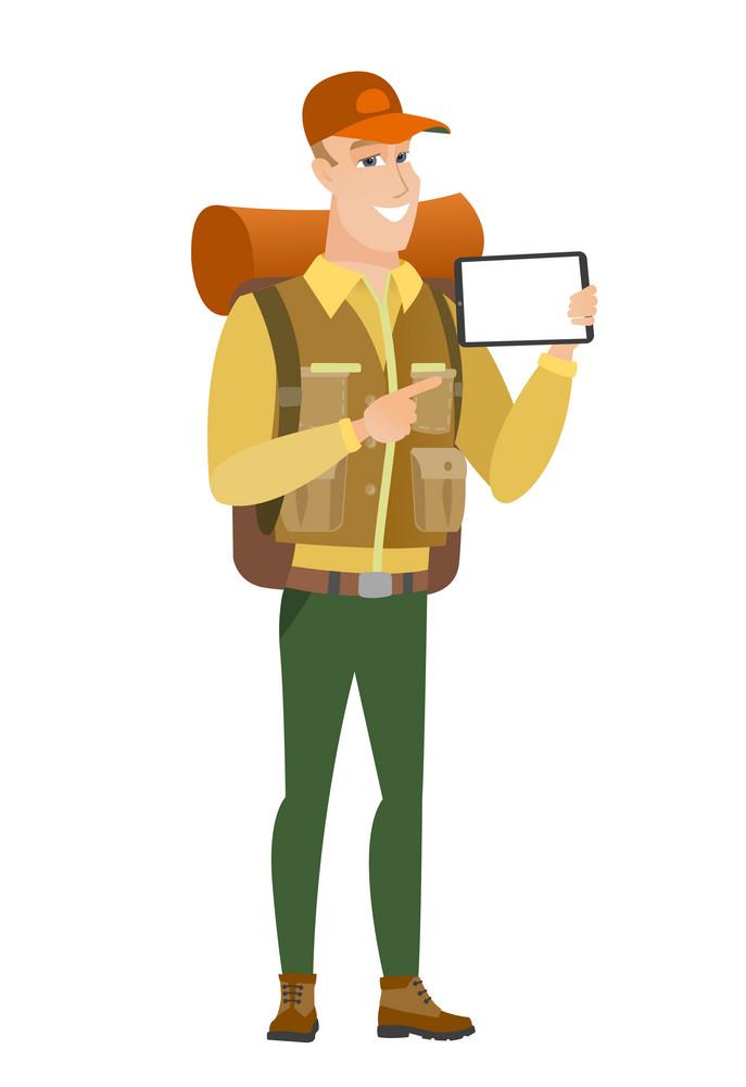 Caucasian traveler holding tablet computer. Full length of traveler pointing at tablet computer. Traveler with tablet computer. Vector flat design illustration isolated on white background.
