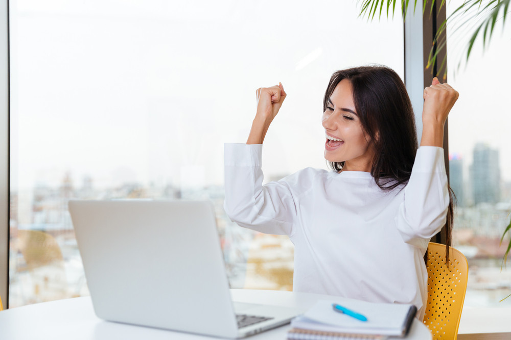 Cheerful Successful Young Businesswoman With Laptop Shouting And Celebrating Success In Office Royalty Free Stock Image Storyblocks