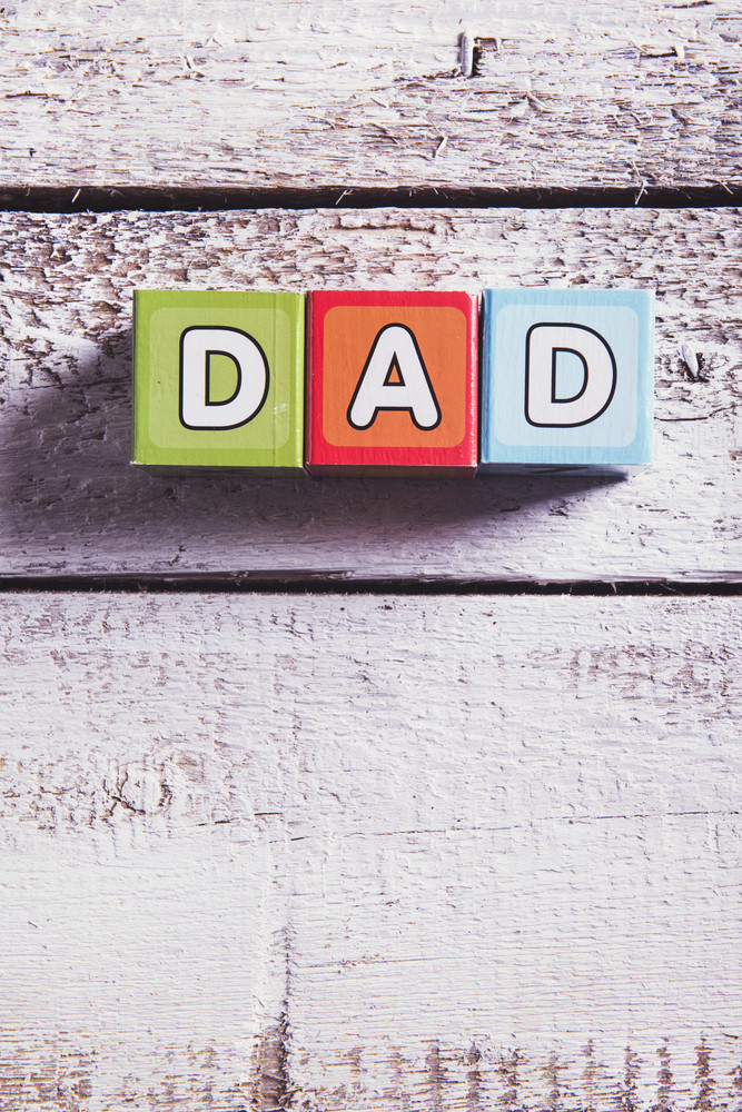 Childrens cubes with dad sign on wooden background