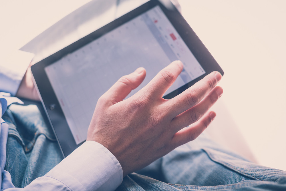 close up hands multitasking man using tablet connecting wifi
