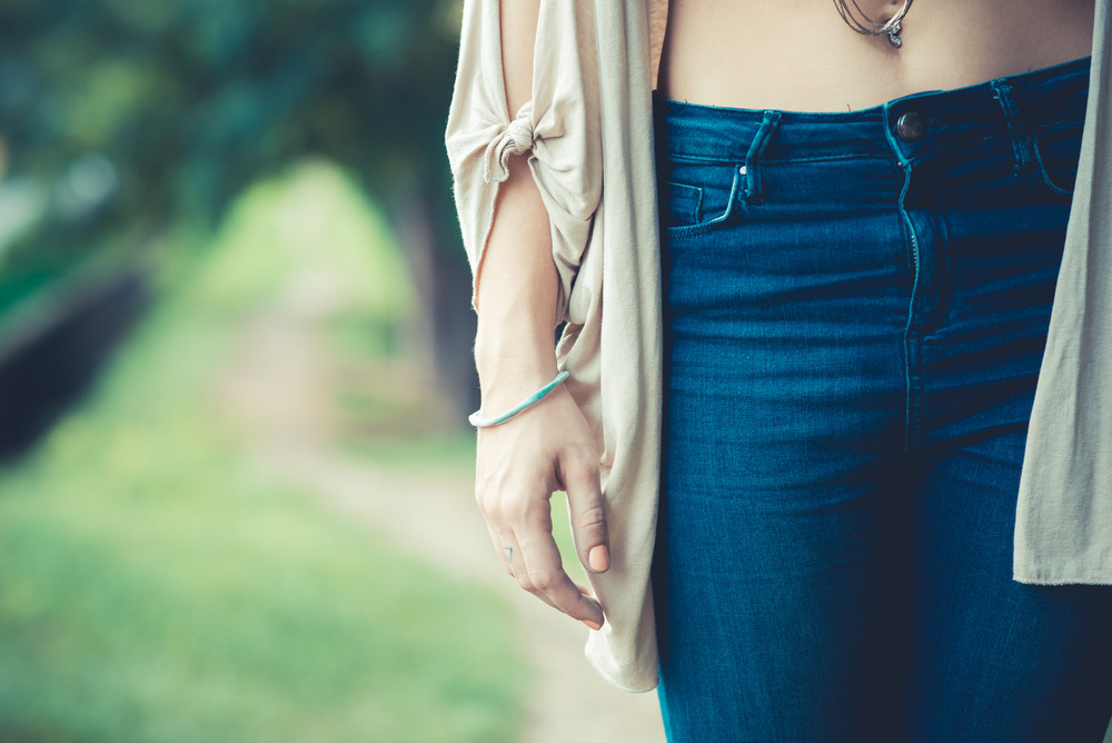 close up of belly button of young woman outdoor