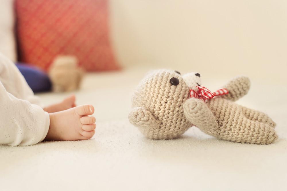 Close up of newborn baby girl's feet