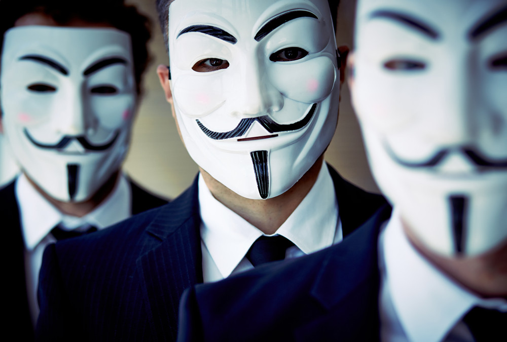 Close-up of unknown people wearing anonymous masks