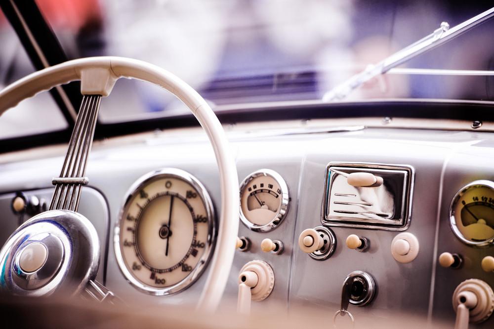 Close up of veteran car, dashboard, windshield, steering wheel, sunny summer day