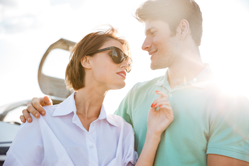 Closeup of beautiful young couple near small airplane