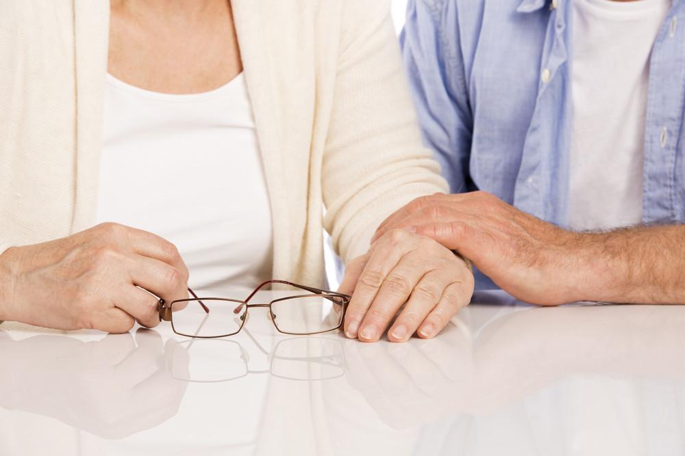 Closeup photo of senior couple holding hands