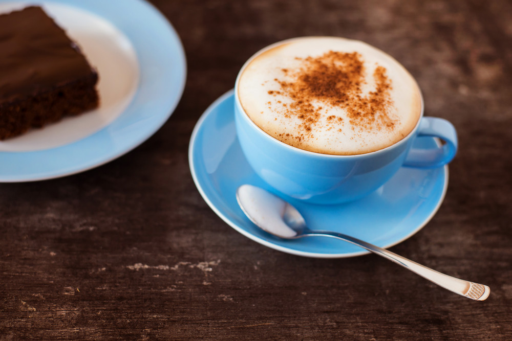 Coffee and cake on a wooden table background