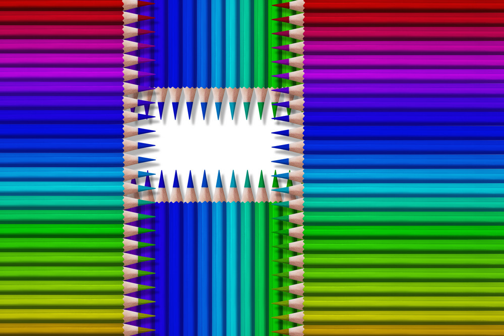 composition of colored pencils on white background