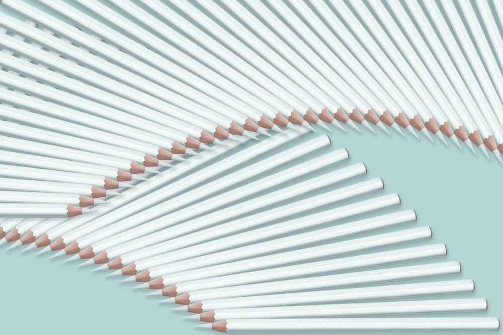 composition of pastel light blue color pencils