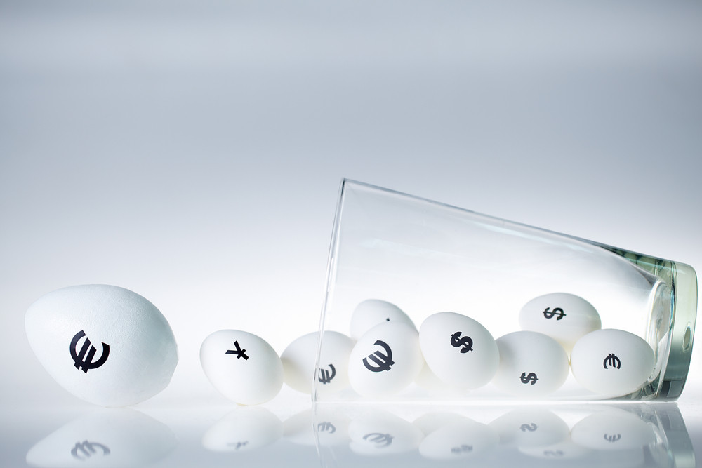Conceptual image of eggs with currency