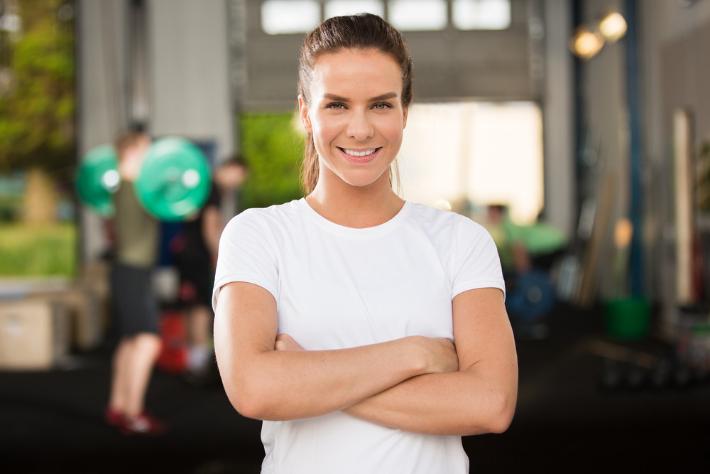 Confident and beautiful woman at fitness gym