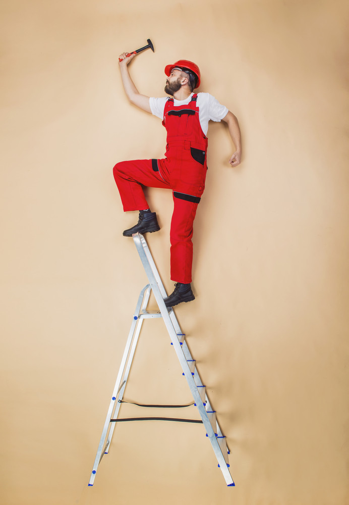 Construction worker have an accident. Funny studio pose.