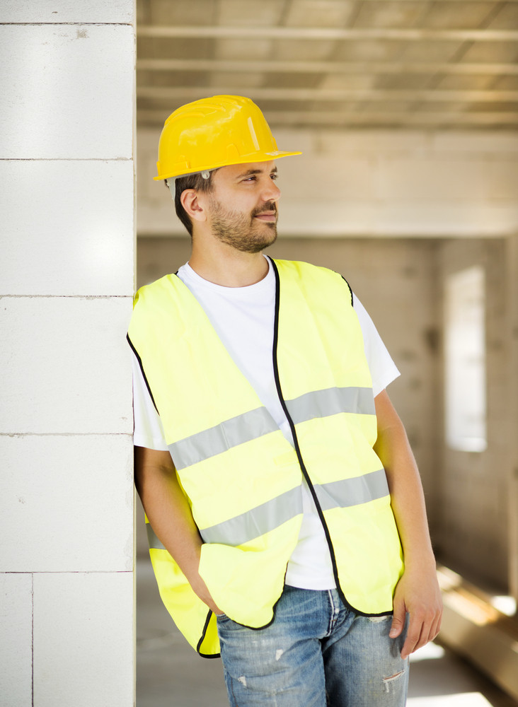 Construction worker is working on new house