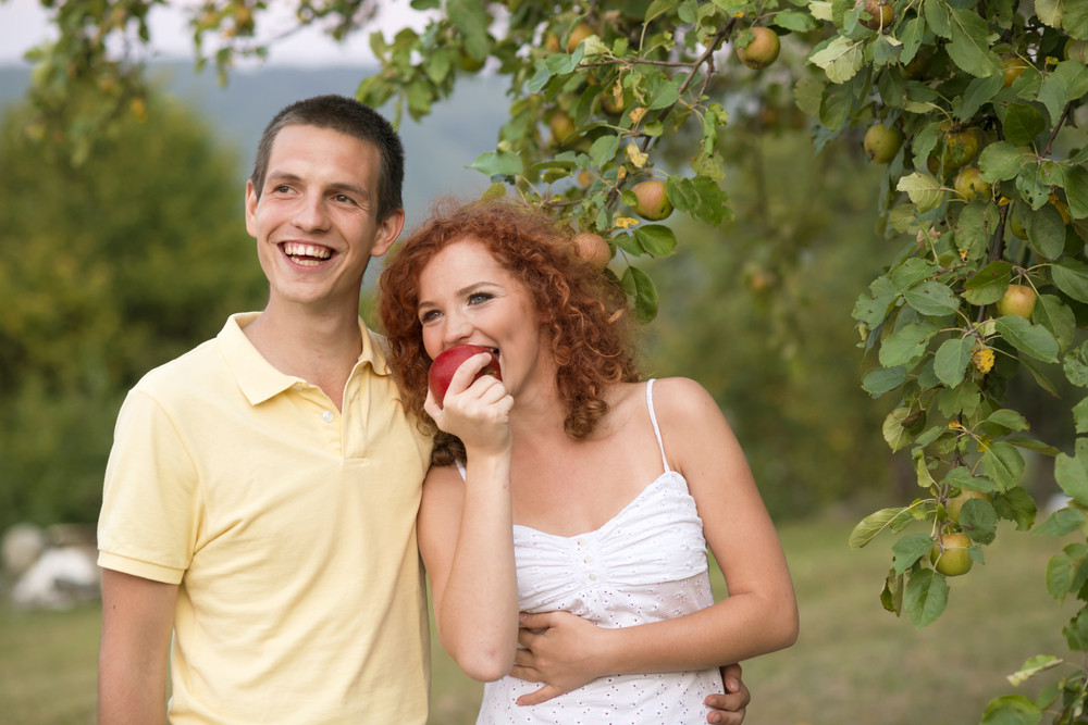 Couple with fruit is having fun