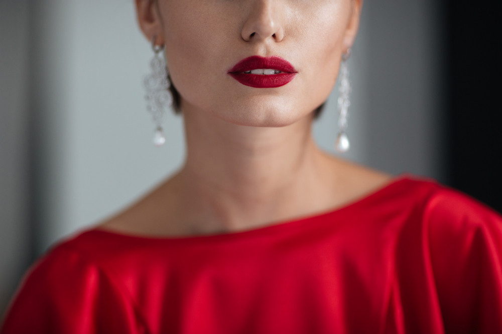 Cropped girl in red dress. red lips.
