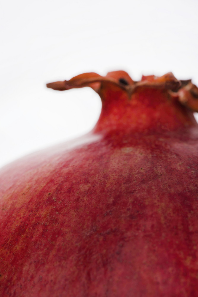 Cropped image of a pomegranate isolated on white background