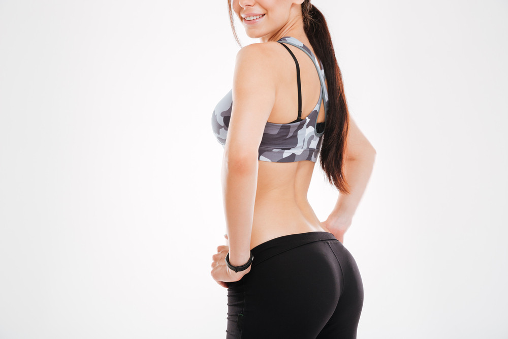 Cropped image of aerobic woman in studio. stands sideways