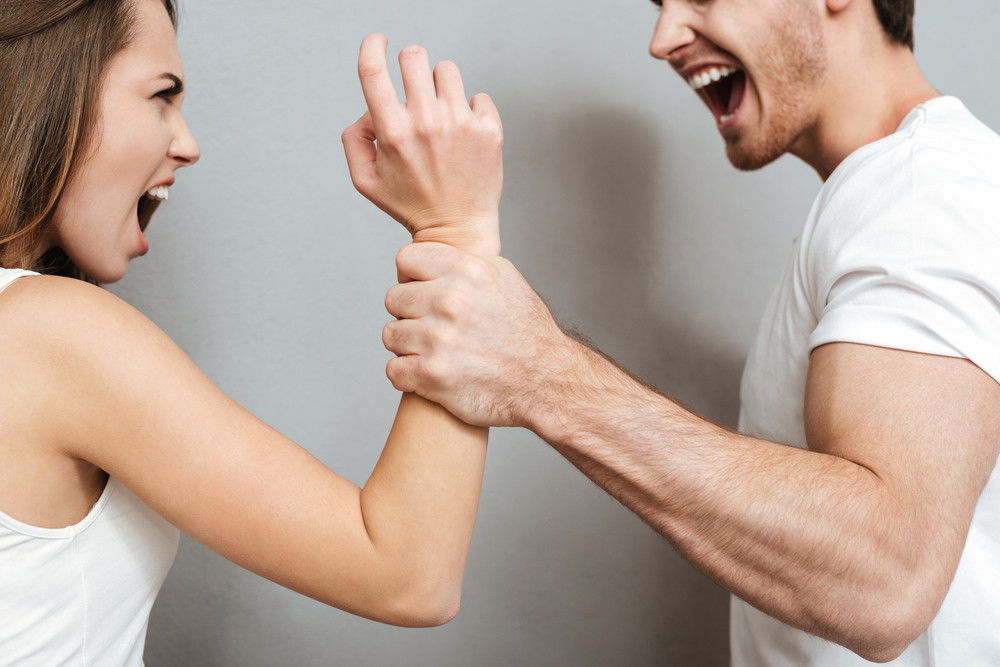 Cropped image of Couple in quarrel in studio. Isolated gray background